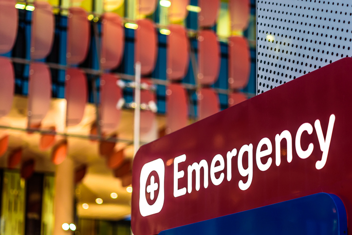 "An ""Emergency"" Sign in front of a hospital in the early evening"